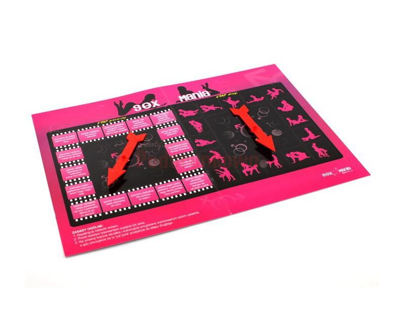 Gra Sex Mania to zestaw zawierający planszę do gry z instrukcją (format A3), strzałki do losowania oraz 2 eleganckie kieliszki do wina (wysokie na 20 cm).