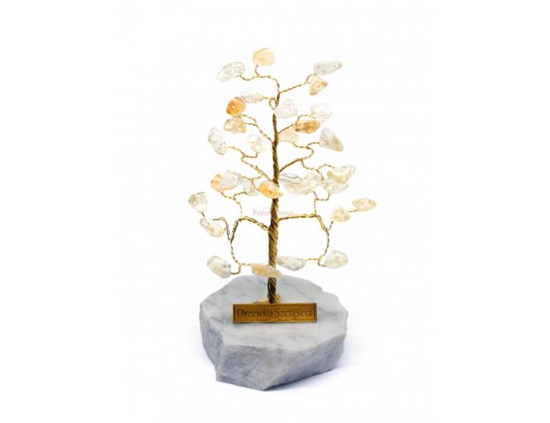 Piękne drzewko szczęścia składające się z delikatnych, lśniących kamieni cytrynu. Cytryn jest bardzo rzadką, żółtą odmianą Kwarcu.
