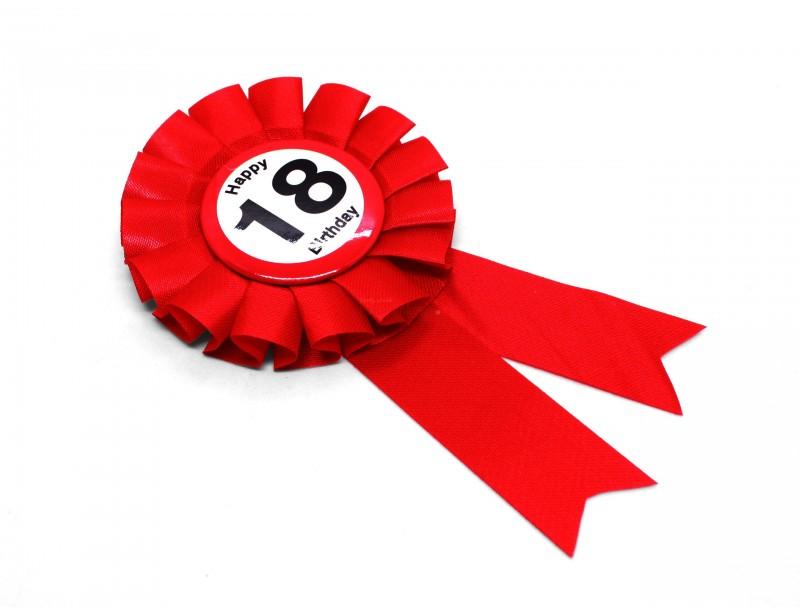 Śliczny, intensywnie czerwony kotylion to idealny dodatek do prezentu z okazji 18 urodzin. Kotylion jest zapinany od tyłu na wygodną agrafkę z zabezpieczeniem.